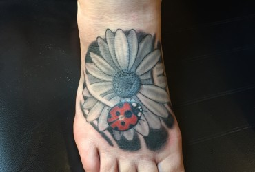 Flower and ladybug tattoo by Ben Chambers